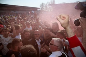 Danny Cowley is mobbed by fans.