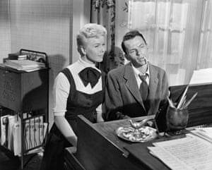 Doris Day and Frank Sinatra singing at the piano in the film Young at Heart, 1954