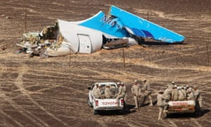 Egyptian servicemen approaching a piece of wreckage of Russian MetroJet Airbus A321 at the site of the crash in Sinai.