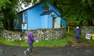 voters at a polling station in water yeat, cumbria