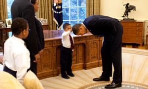 Obama bending over so the son of a White House staff member can pat his head, 8 May 2009.
