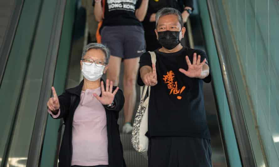 Former lawmakers Lee Cheuk-yan, (right), and Cyd Ho, (left), leave the West Kowloon court buildings in Hong Kong on Thursday.