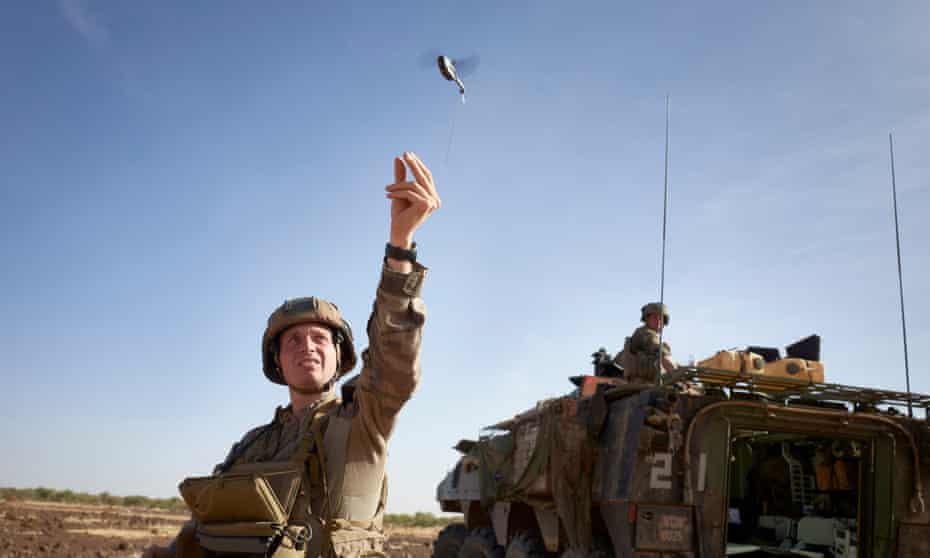 A French soldier launches a drone in northern Burkina Faso.