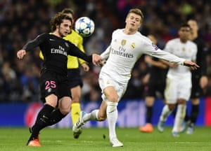 Paris Saint-Germain's Adrien Rabiot, left, vies with Real Madrid's Toni Kroos.