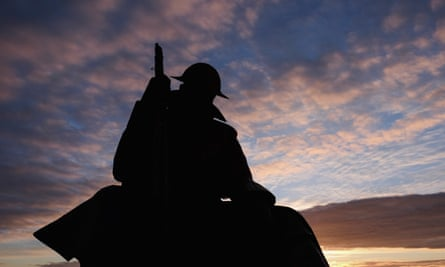 dawn breaks over the statue of a first world war soldier, Tommy, on 29 June 29 in Seaham, England.