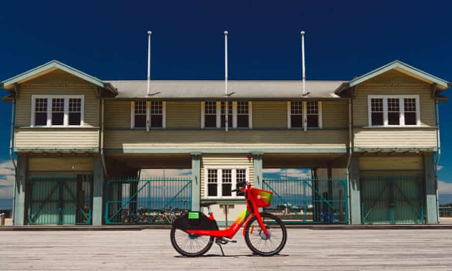 A Lime e-bike outside a beachside bather's pavilion