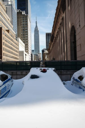 NYPD cars covered in snow