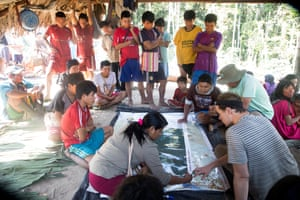 Villagers in Tankoari take part in Cool Earth's mapping exercises to establish the locations of areas cleared for cultivation of yucca, the food staple. With the aid of satellite maps, the local population can plan their land use and reduce deforestation.