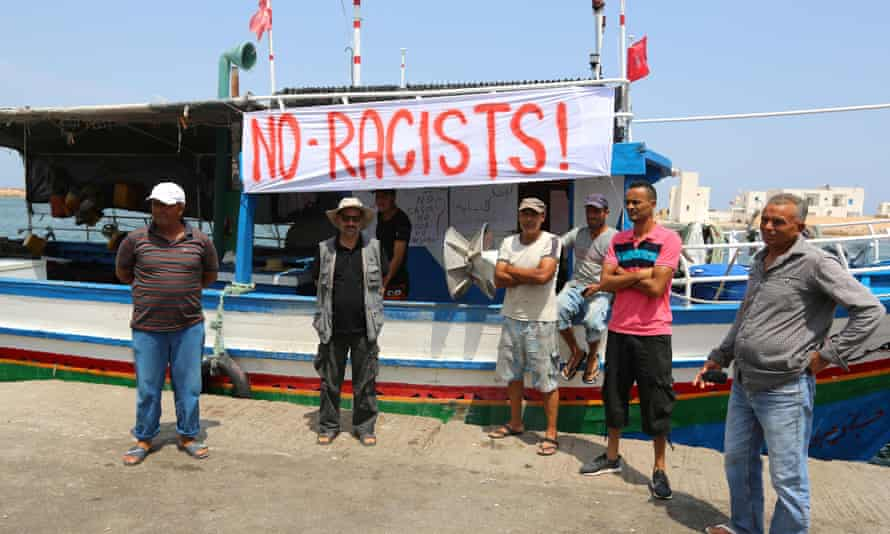 Tunisian fishermen gathered in Zarzis to protest against the C-Star. A port official said authorities would 'never let in racists'.