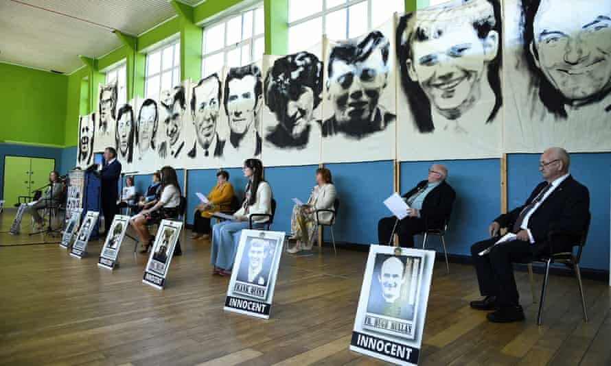 Family members of the Ballymurphy victims attend a news conference after listening to the findings of the inquest report