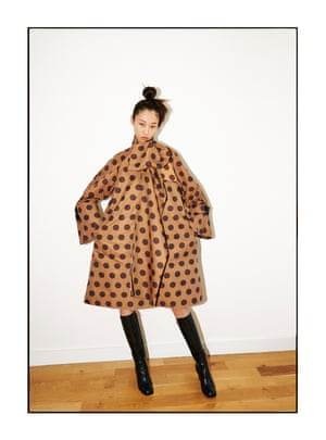 Jiang wears a Loewe coat dress, £1,895, and boots, £895