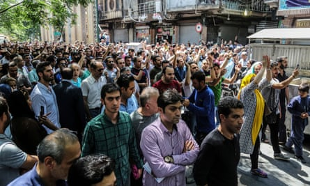 Protesters in Tehran's Grand Bazaar voice anger over Iran's economic problems.
