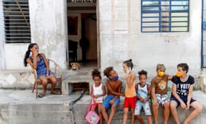 Children talk while wearing masks to protect themselves from the coronavirus pandemic in Havana, Cuba, on 7 August 2020.