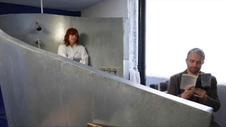 Jennifer Dalton and William Powhida sit in the bathroom in one of the apartments used in the project.