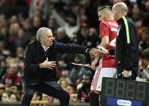 Manchester United José Mourinho gestures as Morgan Schneiderlin prepares to come on.