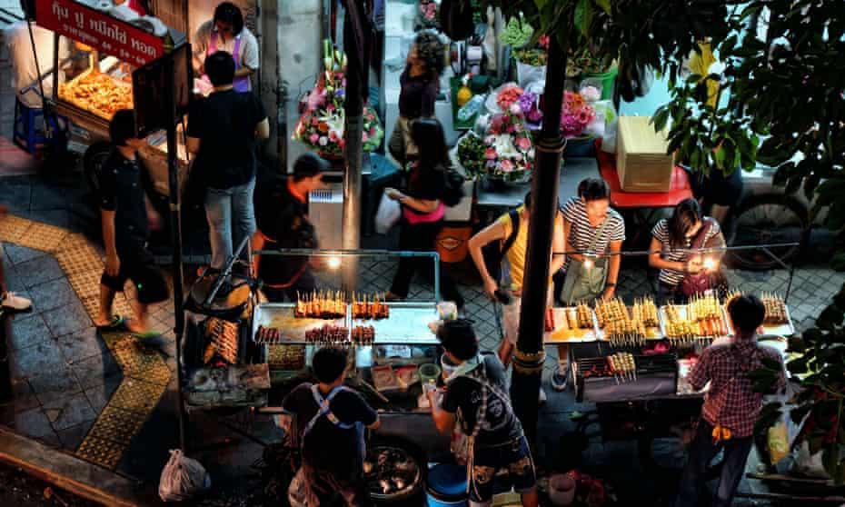Tuck stop … street food stalls at the corner of Soi Saladaeng and Silom Road, Bangkok, Thailand