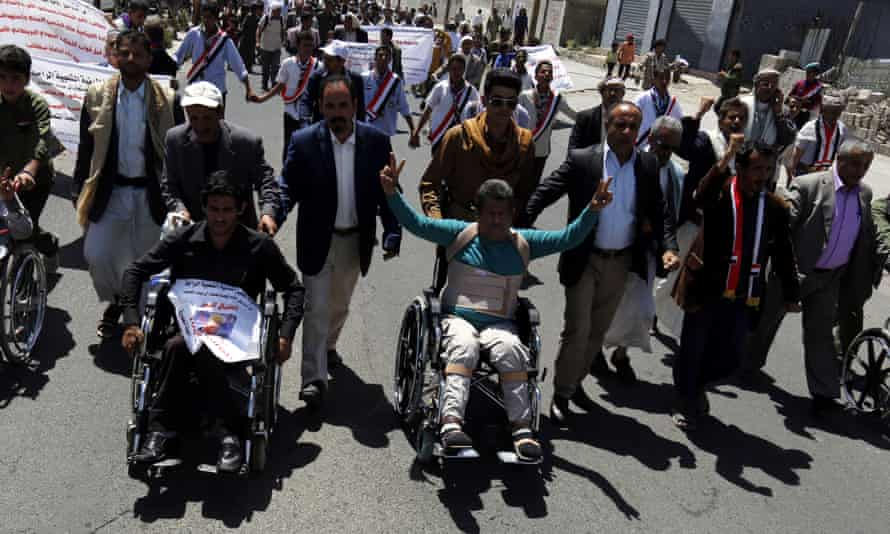 Yemeni protesters march in Sana'a on 19 April.