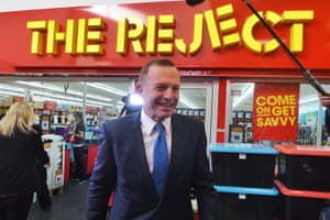 A PR gaffe by the Prime Minister's team as Tony Abbott walks past a 'Reject' sign on his way to visit a butcher's shop in Canberra on 4 June. By September the PM would indeed be rejected – by his own party – in a vote brought about by Malcolm Turnbull's leadership challenge.