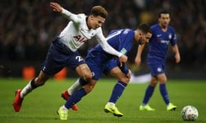 Eden Hazard of Chelsea tussles with Dele Alli of Tottenham Hotspur.