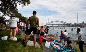 Spectators race to secure a spot to view the New Year's Eve fireworks in Sydney