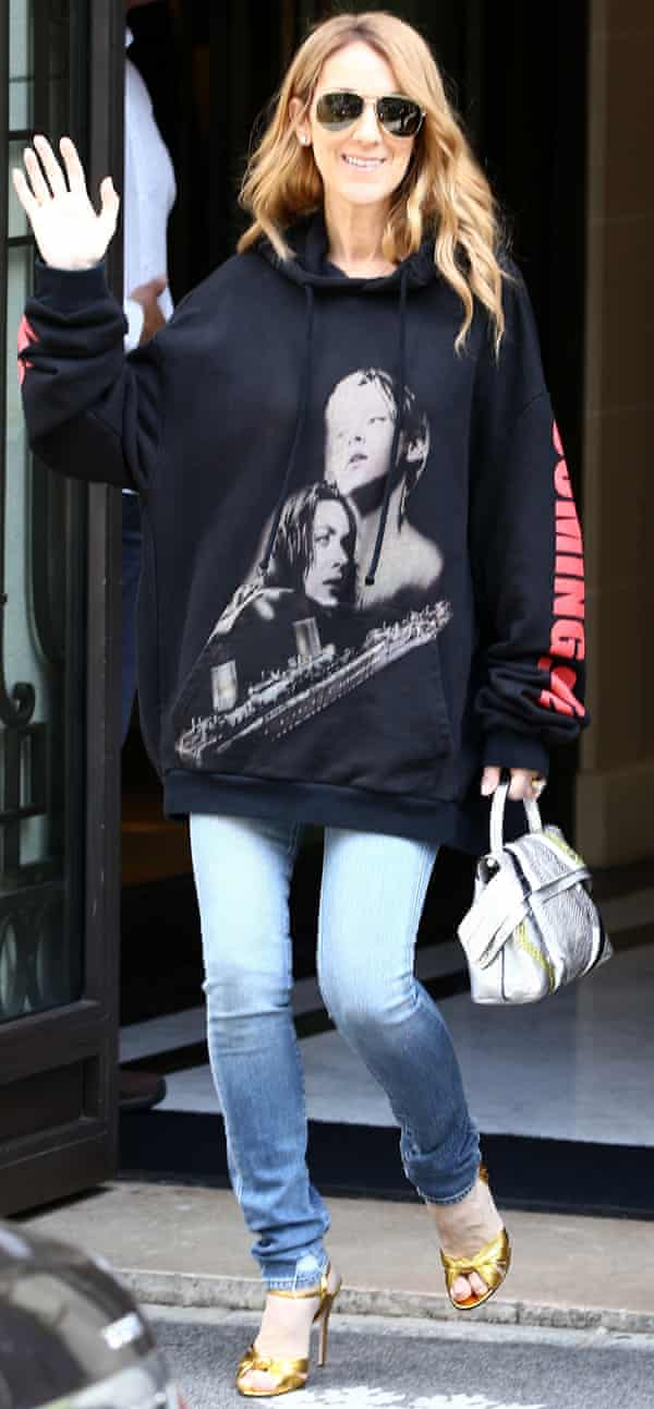 Celine Dion July 09, 2016 Singer Celine Dion, sporting a sweater with Leonardo DiCaprio and Kate Winslet in the film 'Titanic' on it, waves to her fans as she leaves the Royal Monceau palace hotel in Paris, France.