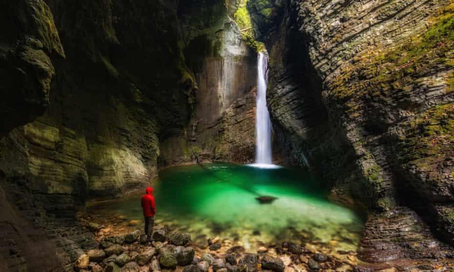 Man in front of Kozjak waterfall, Soca Valley, Slovenia.