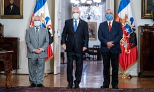Chilean President Sebastian Pinera, new Health Minister Oscar Enrique Paris and former Health Minister Jaime Manalich attend the cabinet reshuffle at the government house in Santiago, Chile June 13, 2020.
