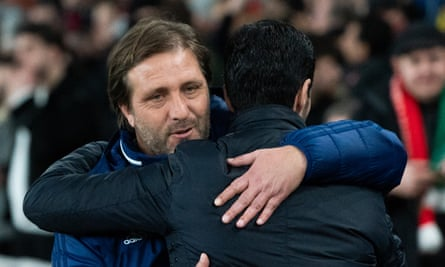Pedro Martins and the Arsenal manager, Mikel Arteta, embrace before their epic second-leg round-of-32 match at the Emirates in February.