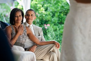 18 June: 'The First Lady reacts as she watches Laura Jarrett and Tony Balkissoon take their vows during their wedding at Valerie Jarrett's home in Chicago'