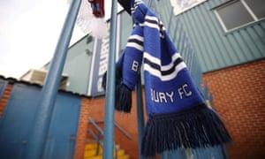 A Bury FC scarf hangs outside the stadium.