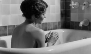 1920s 1930s woman sitting in bath tub13 Oct 1930 --- 1920s 1930s woman sitting in bath tub --- Image by © ClassicStock/Corbis
