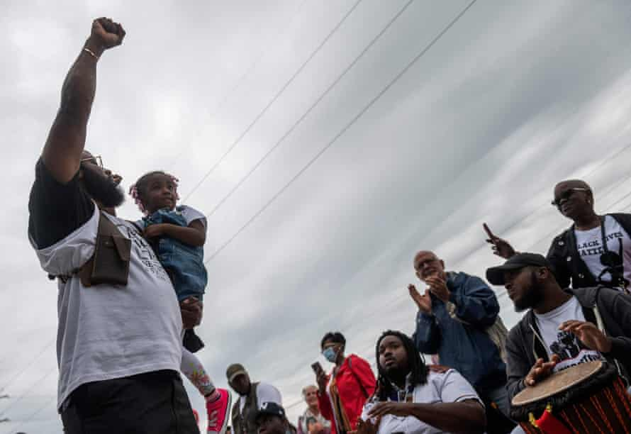 A man gestures after a soil dedication ceremony for victims of the 1921 Tulsa Massacre, at Stone Hill on the 100 year anniversary in Tulsa, Oklahoma, on Monday.