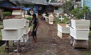 Coffin are prepared for victims of the coronavirus in Jakarta, Indonesia.