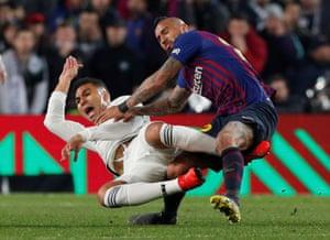 Barcelona's Arturo Vidal fouls Real Madrid's Casemiro.