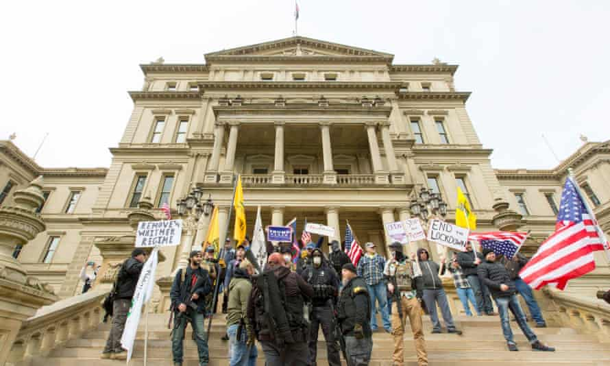 Protesters take part in 'Operation Gridlock' in front of the state capitol in Lansing, Michigan, on 15 April.
