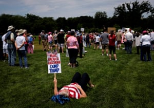 A woman lies in the grass on the National Mall.