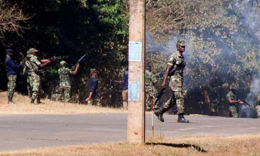 Armed police disperse supporters of the Malawi Congress party