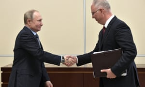 Kirill Dmitriev (right) shaking hands with the Russian president, Vladimir Putin, in January.