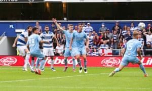 Yoann Barbet (left) doubles Queens Park Rangers' lead.