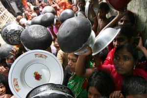 Women and children gather for food in Bangladesh