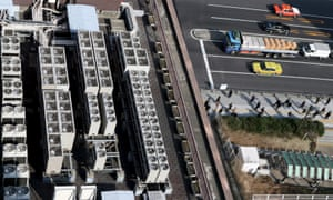 Multiple air-conditioning units on a Tokyo roof.