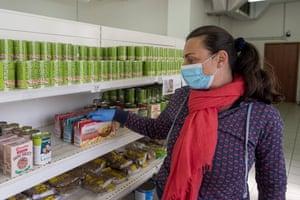 A woman at a church-run food bank in Rome