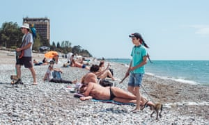 Locals on the beach at Gagra, Abkhazia, who charge tourists to be photographed with animals
