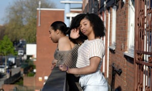 Kelly and her daughter Aaliya on the balcony of their flats