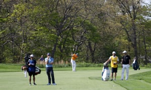 Jordan Spieth plays his second shot on the 10th from the 11th fairway.