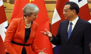 Theresa May and Li Keqiang at a signing ceremony in the Great Hall of the People in Beijing