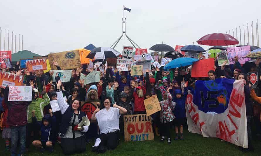 Students striking from school on Wednesday protest climate inaction at Parliament House, Canberra.