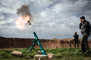 Rebels fire a mortar round at government forces stationed at Kwiriss airport.