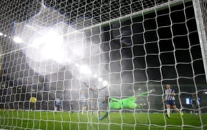 Jamie Vardy celebrates as he scores his first penalty and has to retake it helping Leicester City to a 2-0 away win against Brighton at the AMEX Community Stadium.