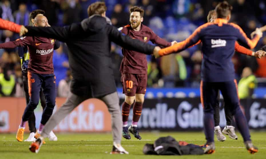 Barcelona's Lionel Messi celebrates with the squad after winning the league title.